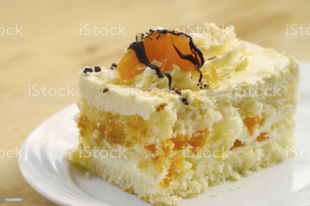 Light spongy cake with Mandarin and cream royalty-free stock photo