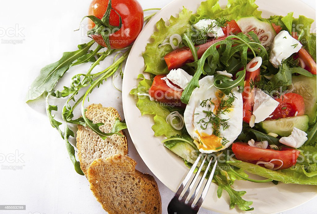 Light spring salad with poached egg royalty-free stock photo