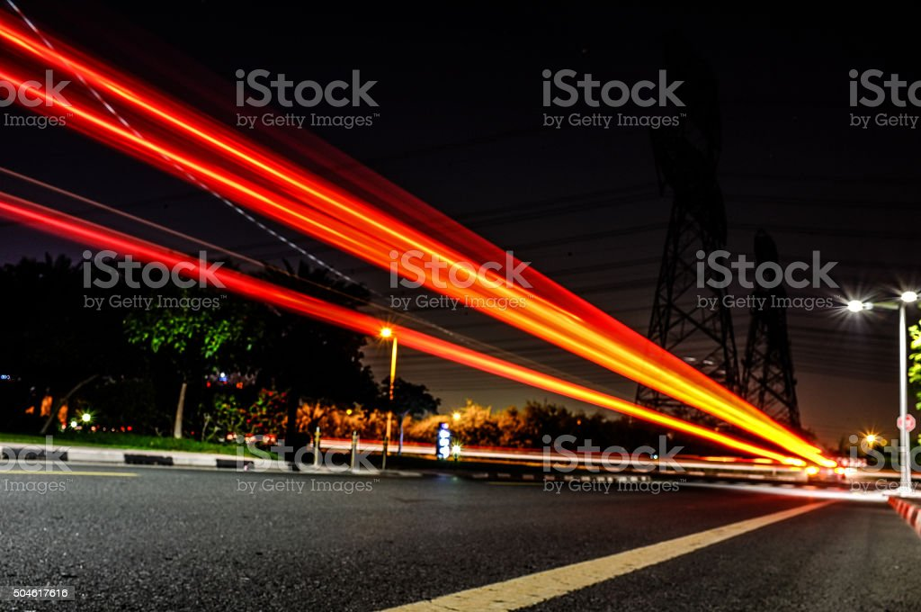 Light Streaks from fast moving automobiles on a busy road stock photo