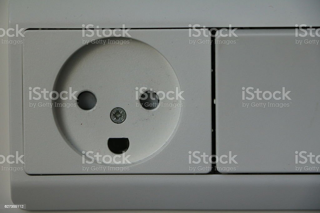 Light switch and smiley socket, Denmark Scandinavia stock photo