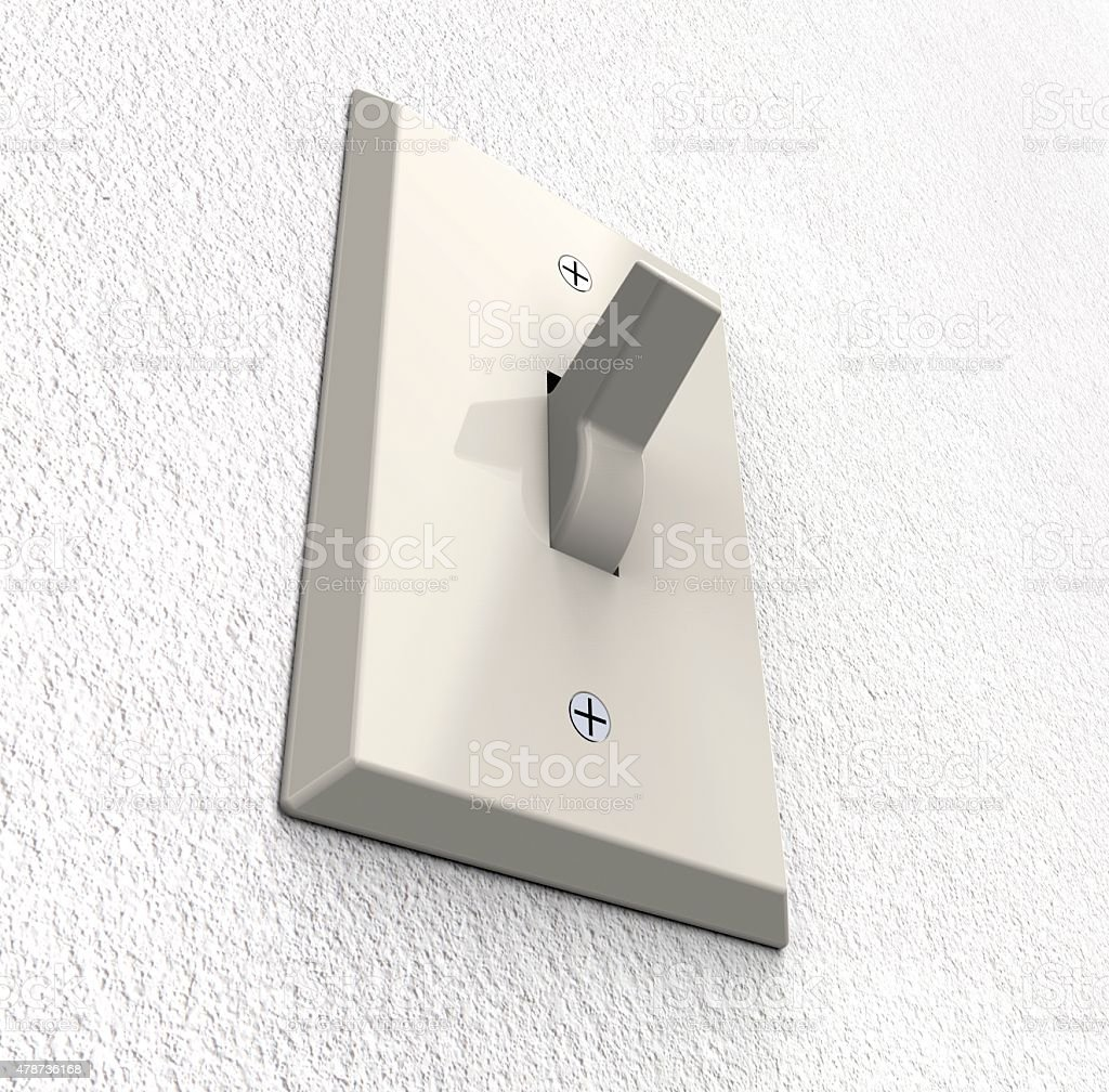 light switch isolated on a wall stock photo
