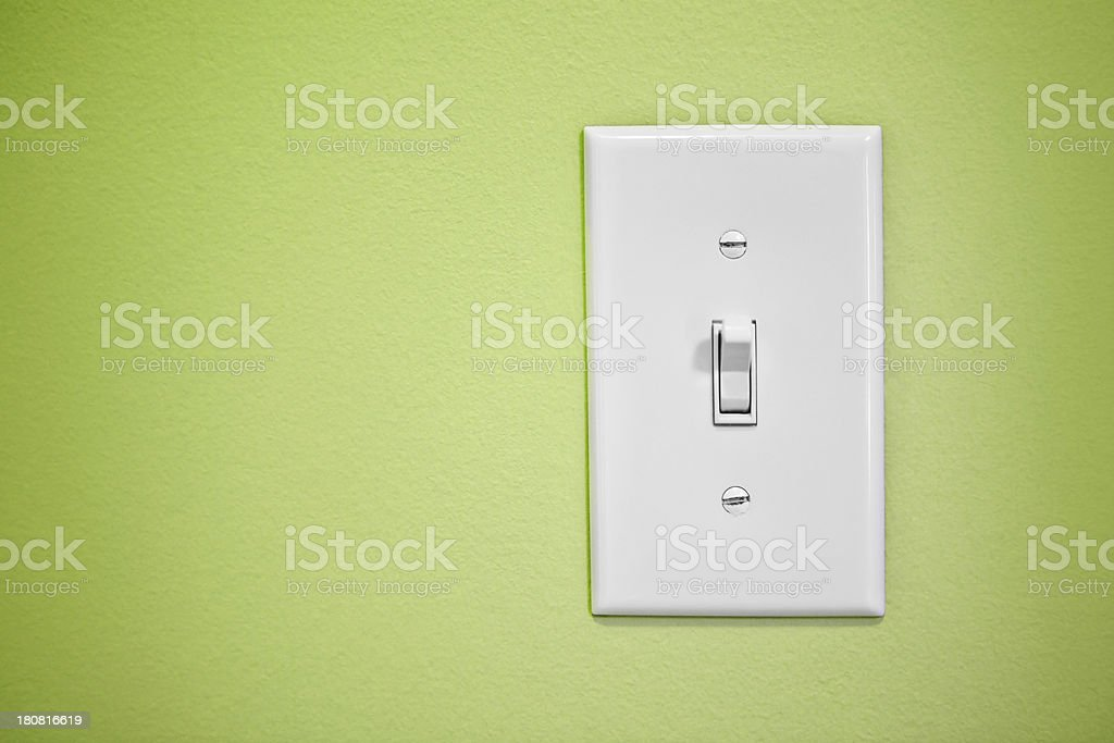 Light Switch On Green Wall stock photo