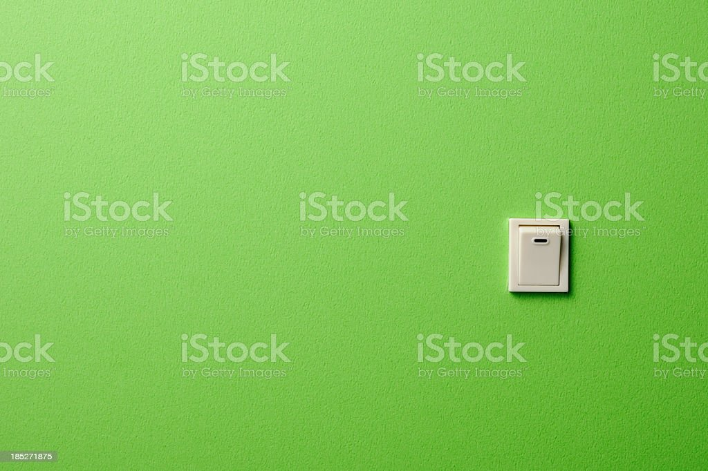 ON OFF light switch on green wall with copy space stock photo