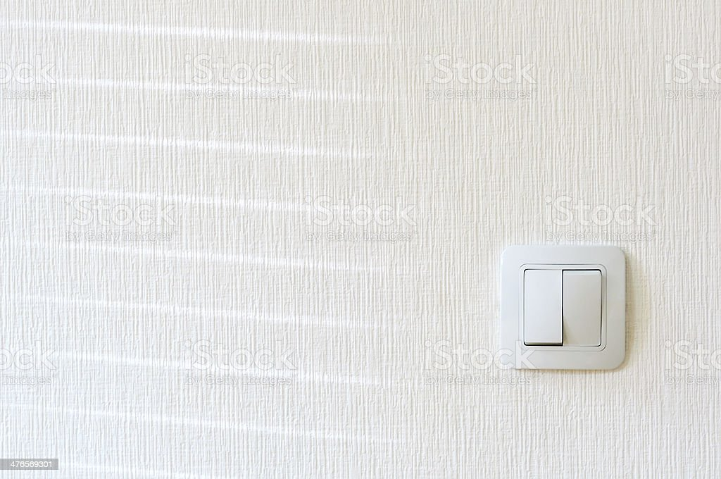 Light switch on the wall stock photo
