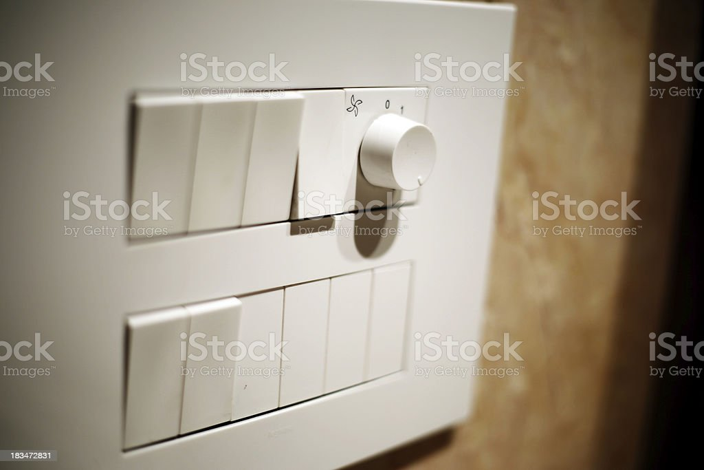 light switch on white board royalty-free stock photo