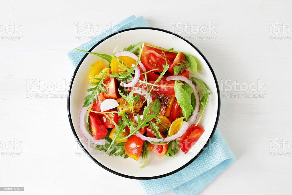 light tomato salad with arugula stock photo