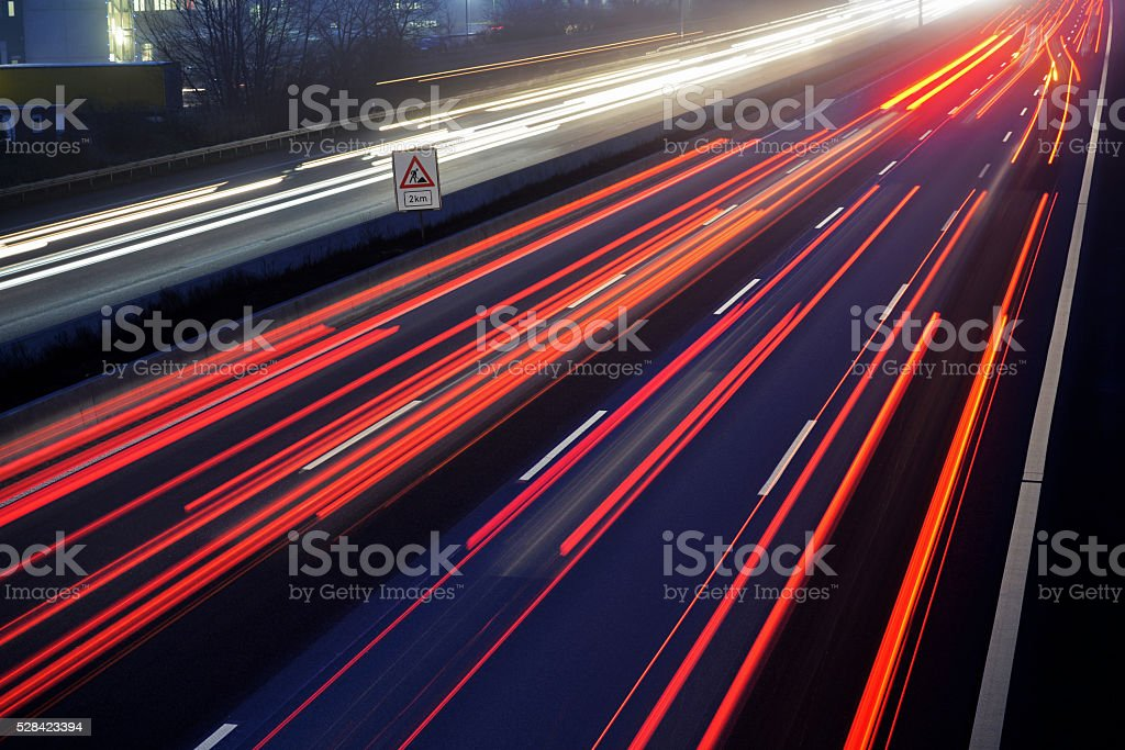 light trail view at a busy highway stock photo