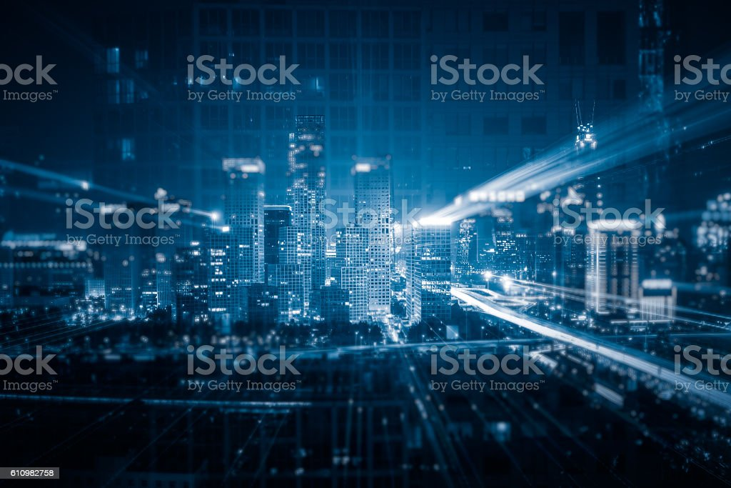 Light trails above buildings stock photo
