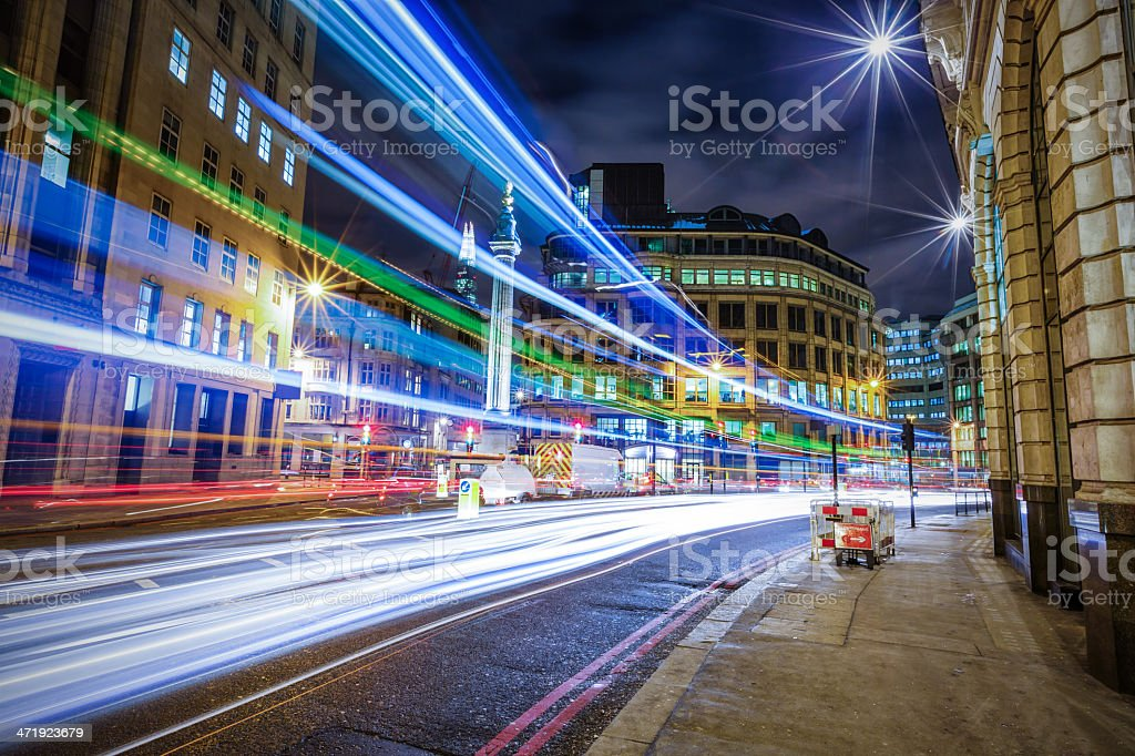 Light trails in City of London at night stock photo