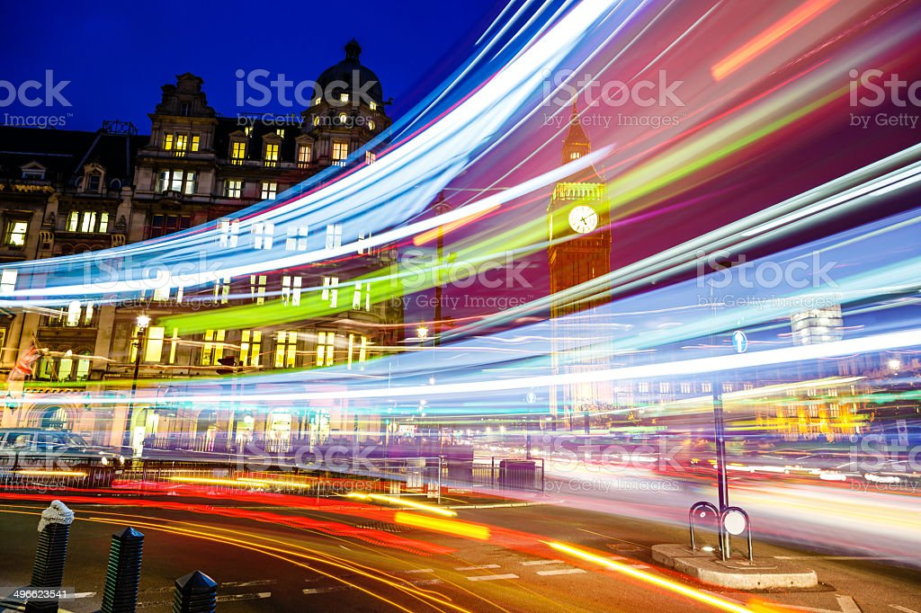 Light trails in front of Big Ben, Westminster, London, UK stock photo