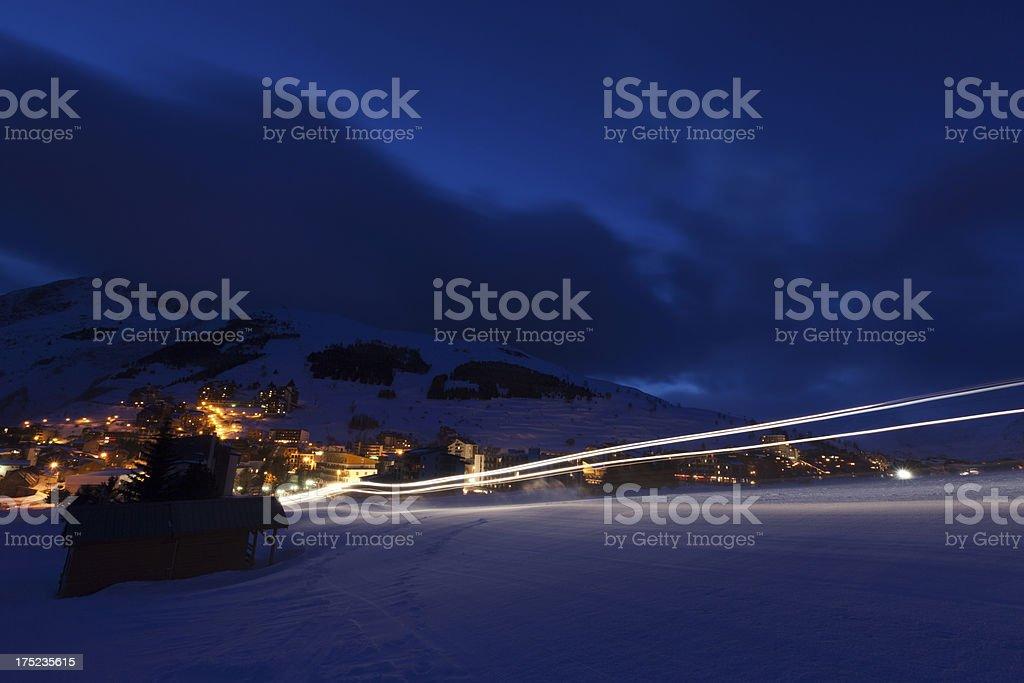 Light trails in ski resort royalty-free stock photo