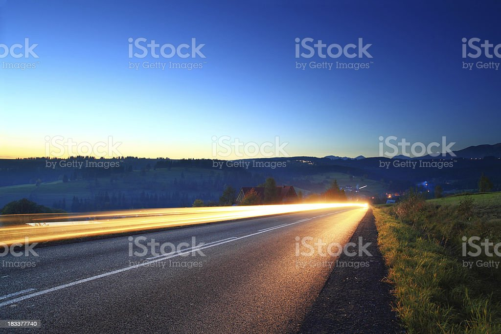 Light trails - mountain road royalty-free stock photo