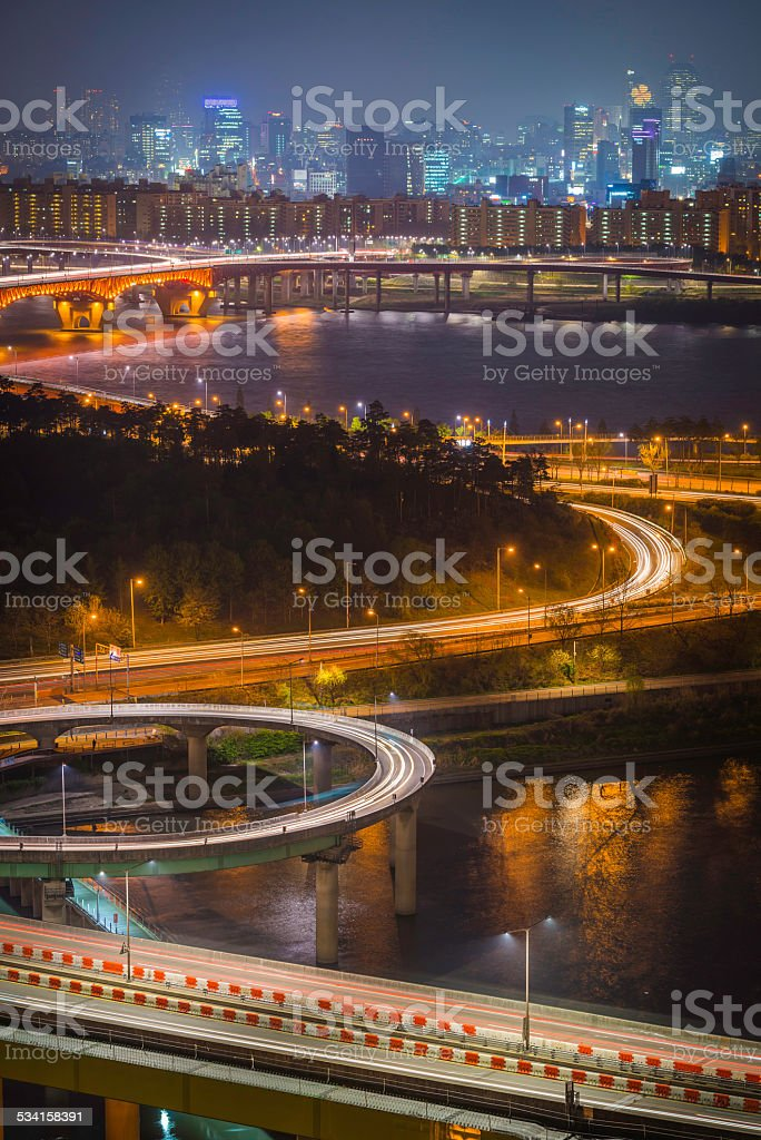 Light trails of zooming traffic on highway loops Seoul Korea stock photo