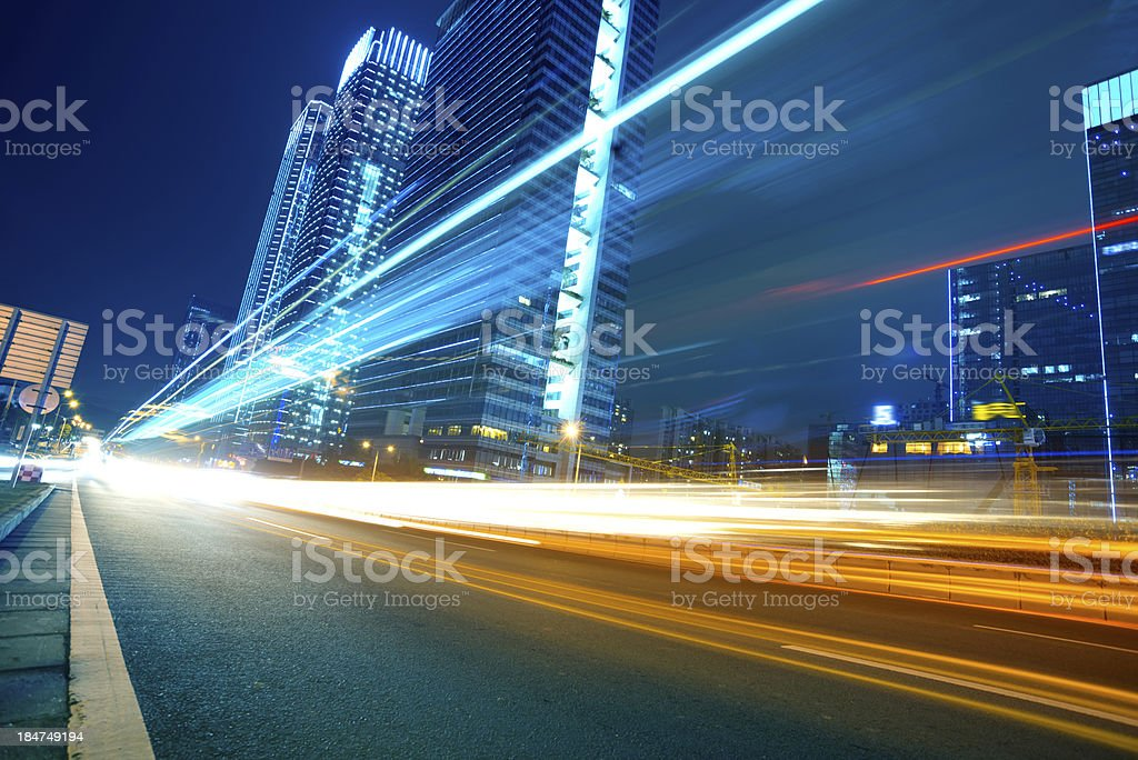 Light trails on a city street stock photo