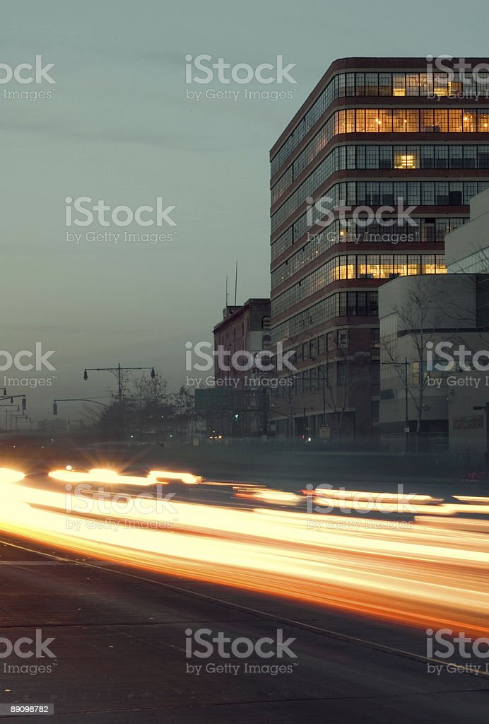 Light trails on a curved road royalty-free stock photo