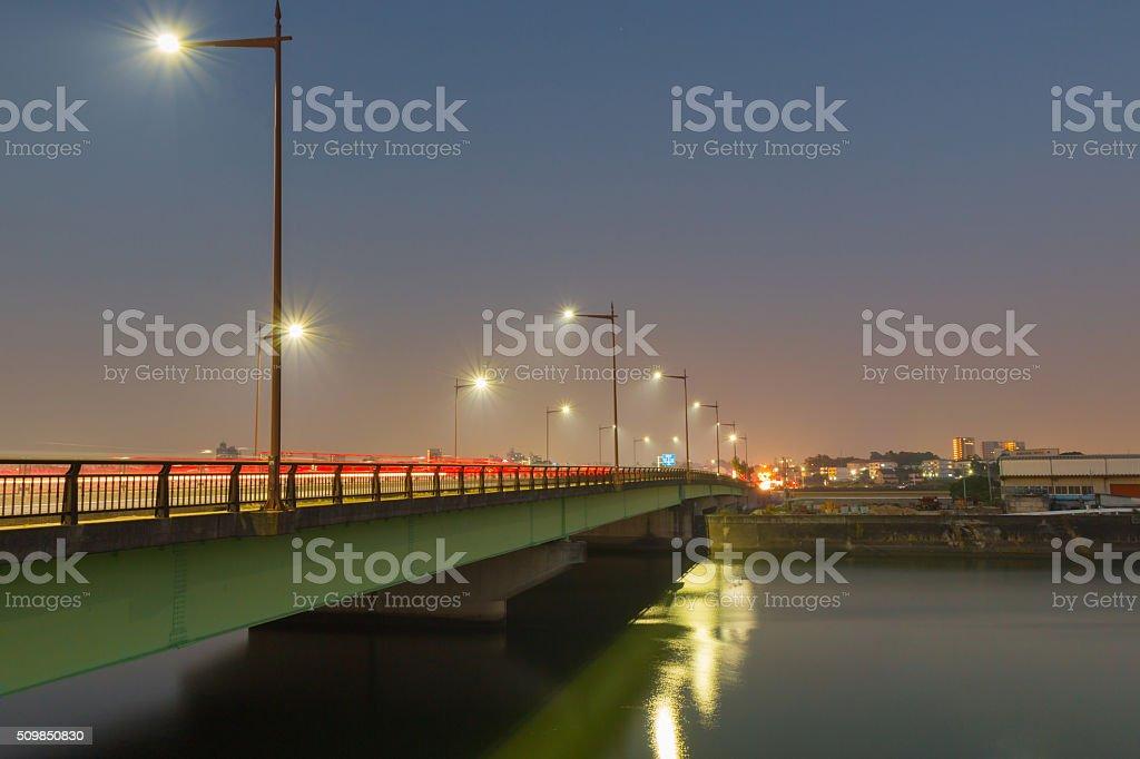 light trails on bridge twilight time. stock photo