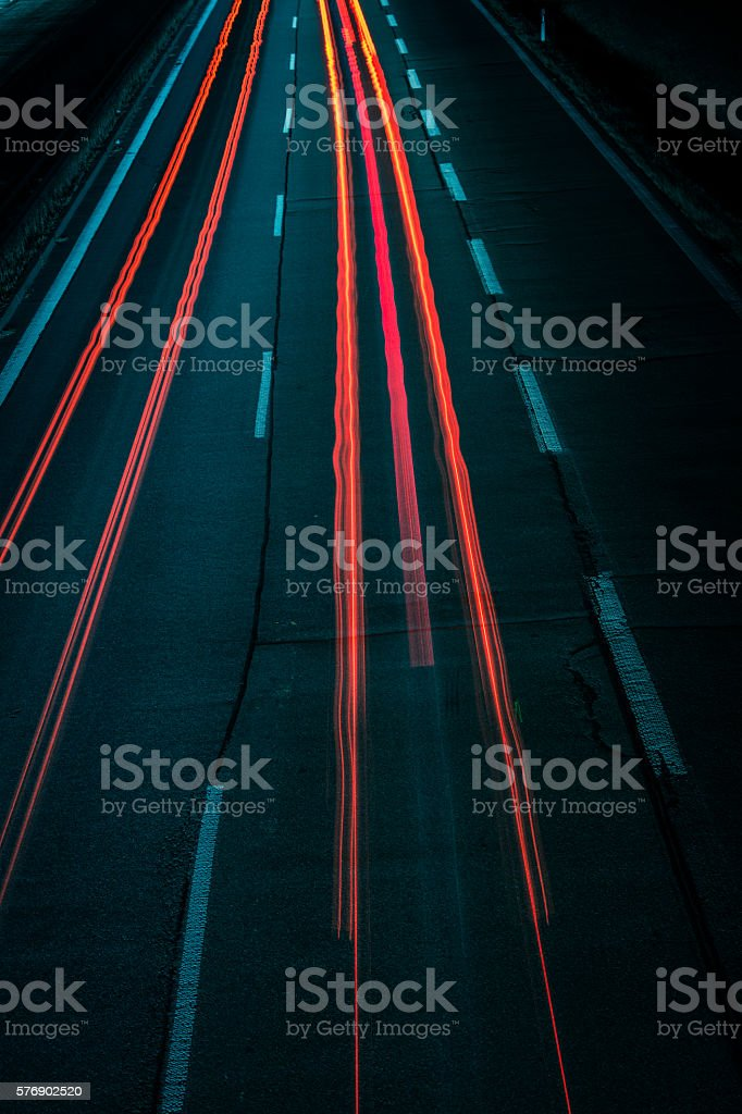 Light trails on road stock photo