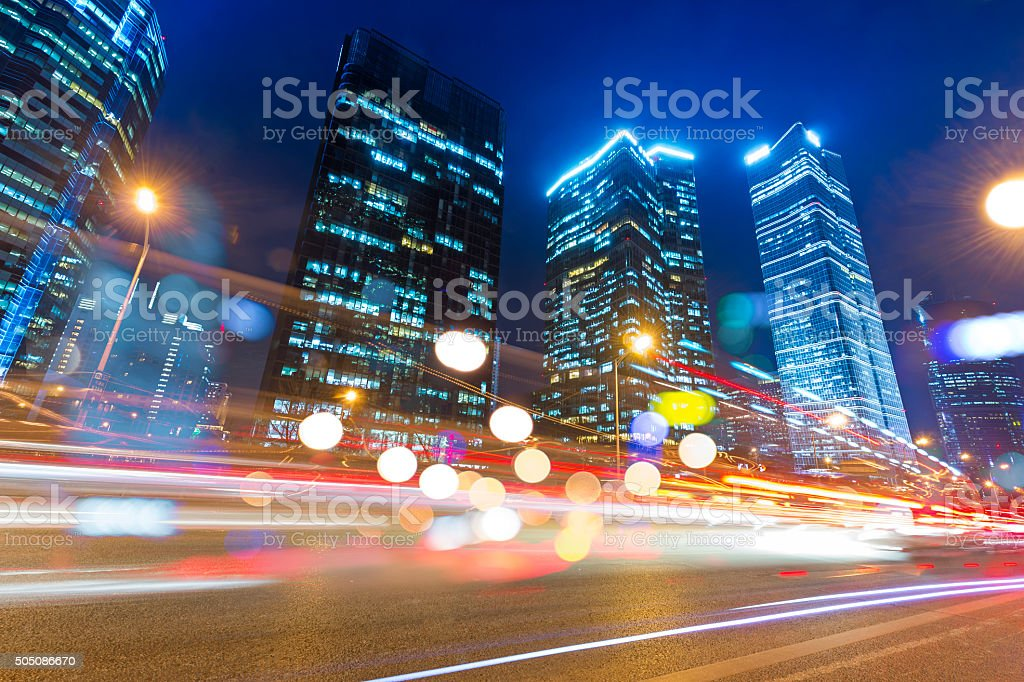 light trails on the modern building background in Beijing china stock photo