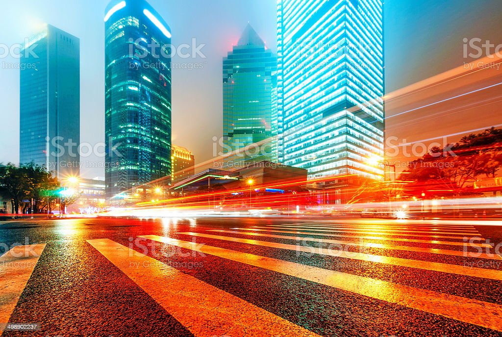 light trails on the modern building background in shanghai china stock photo