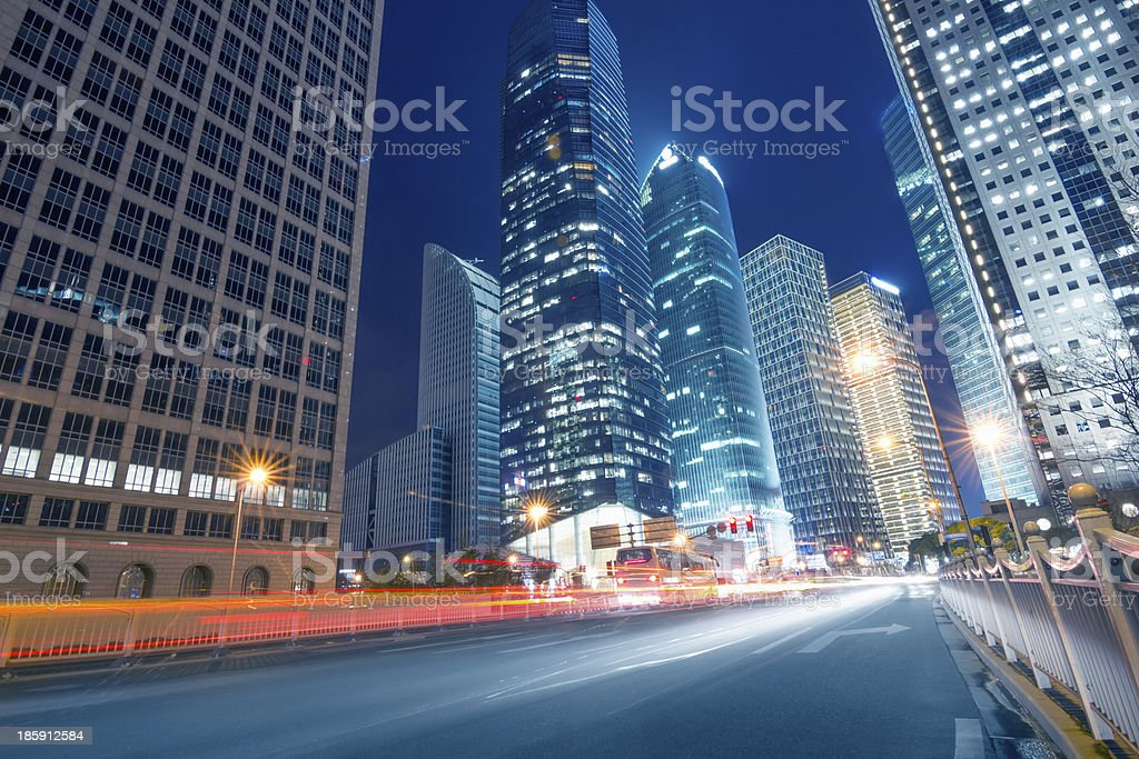 light trails on the street with modern building stock photo