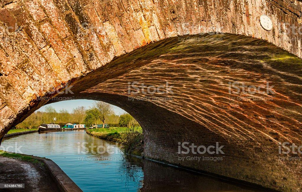 Light waving under the bridge - Waterways stock photo
