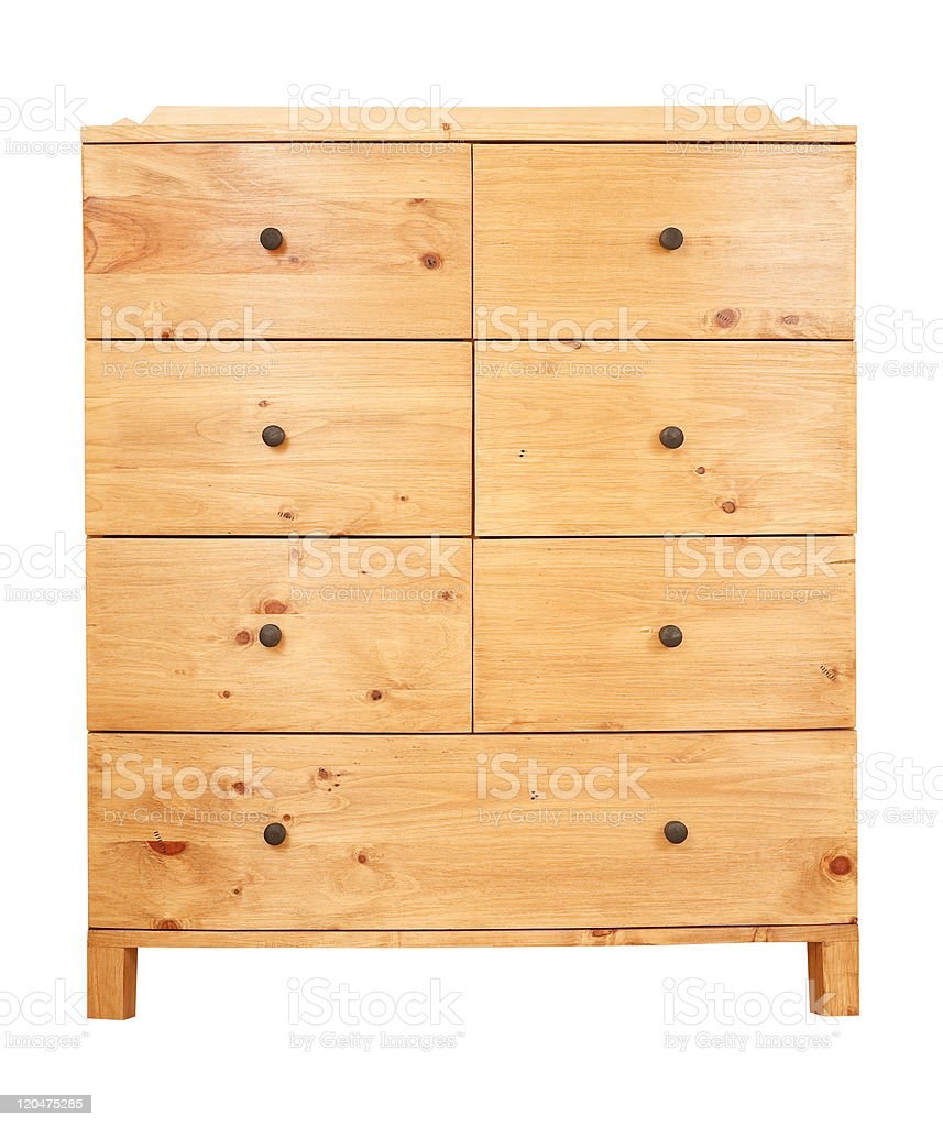 Light wood chest of drawers on small feet stock photo