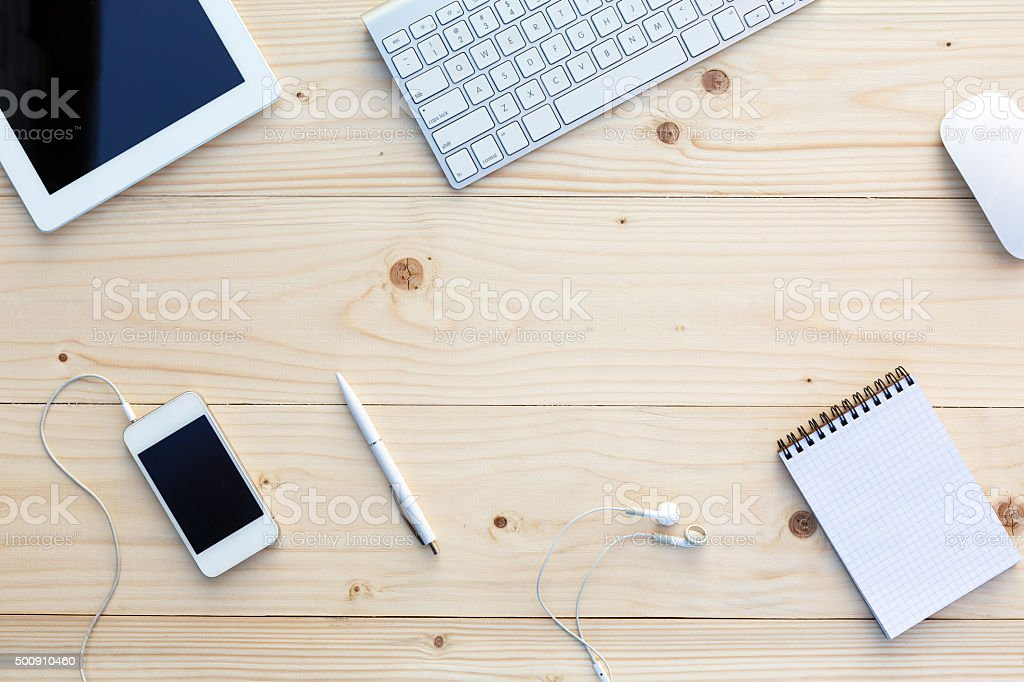 Light wooden Background and modern Business Items on Desk stock photo