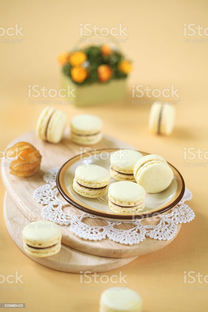 Light Yellow Macarons with Chocolate and Passionfruit Ganache stock photo
