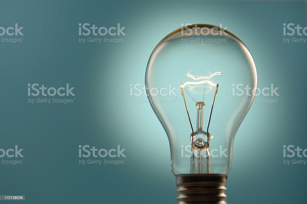 Lightbulb Against Blue Background royalty-free stock photo