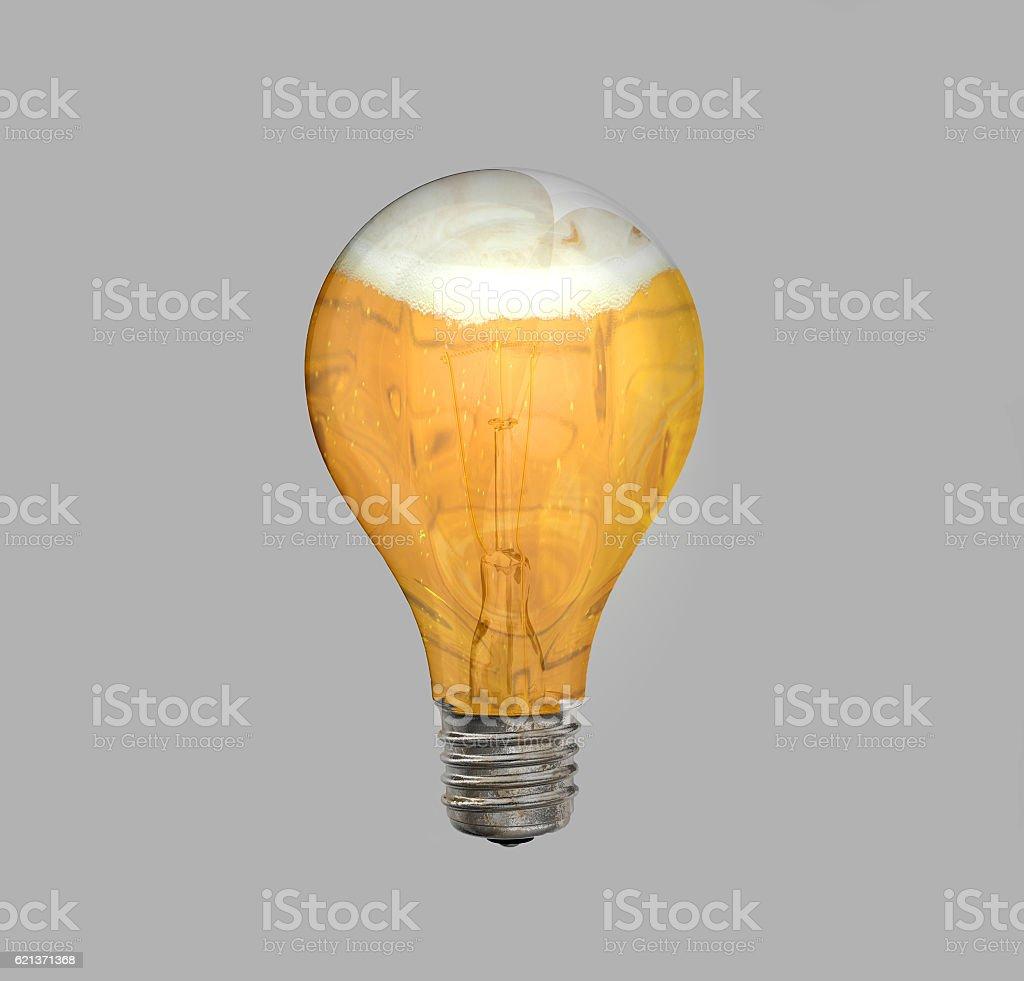 lightbulb full of beer stock photo