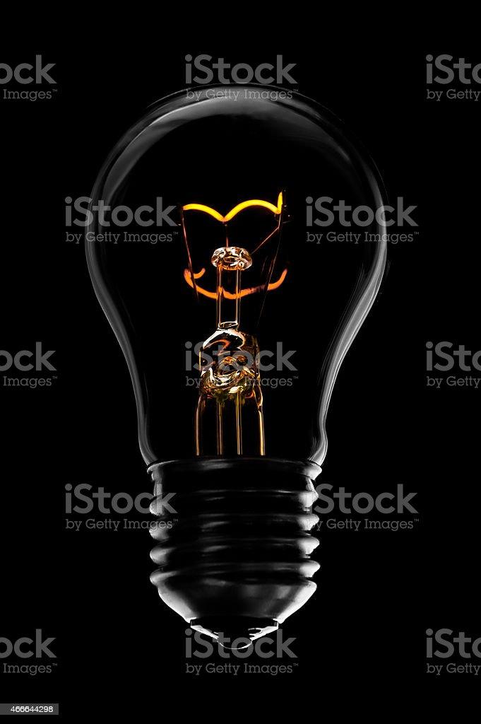 Lightbulb on a black background stock photo