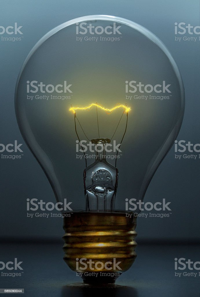 Lightbulb on Dark Blue Background stock photo