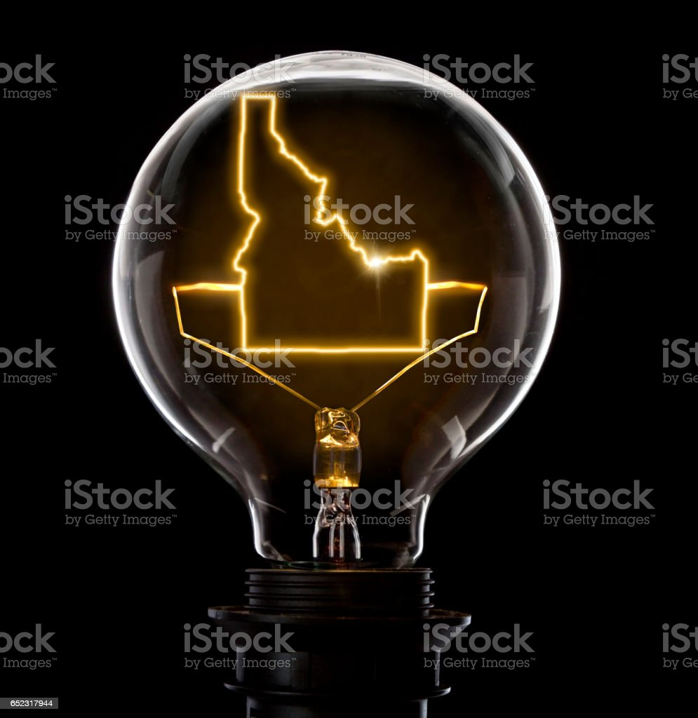 Lightbulb with a glowing wire in the shape of Idaho (series) stock photo