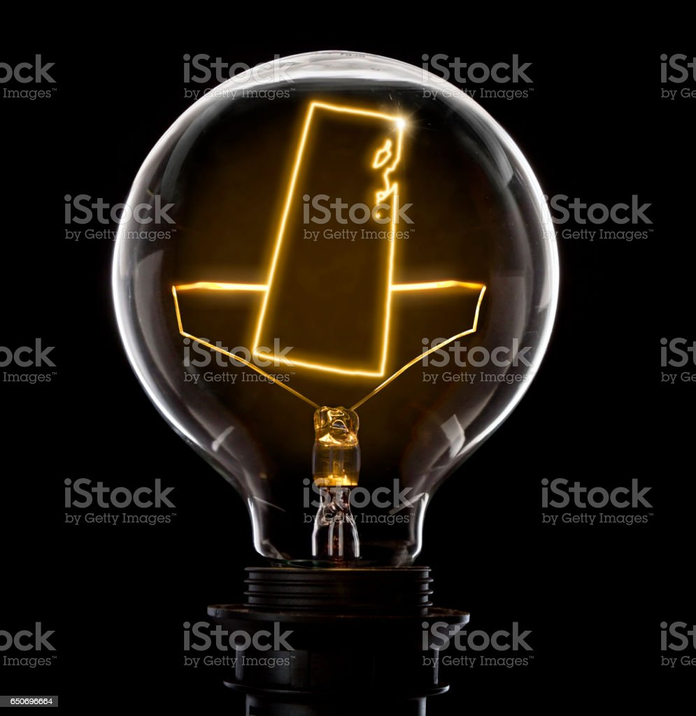 Lightbulb with a glowing wire in the shape of Saskatchewan (series) stock photo