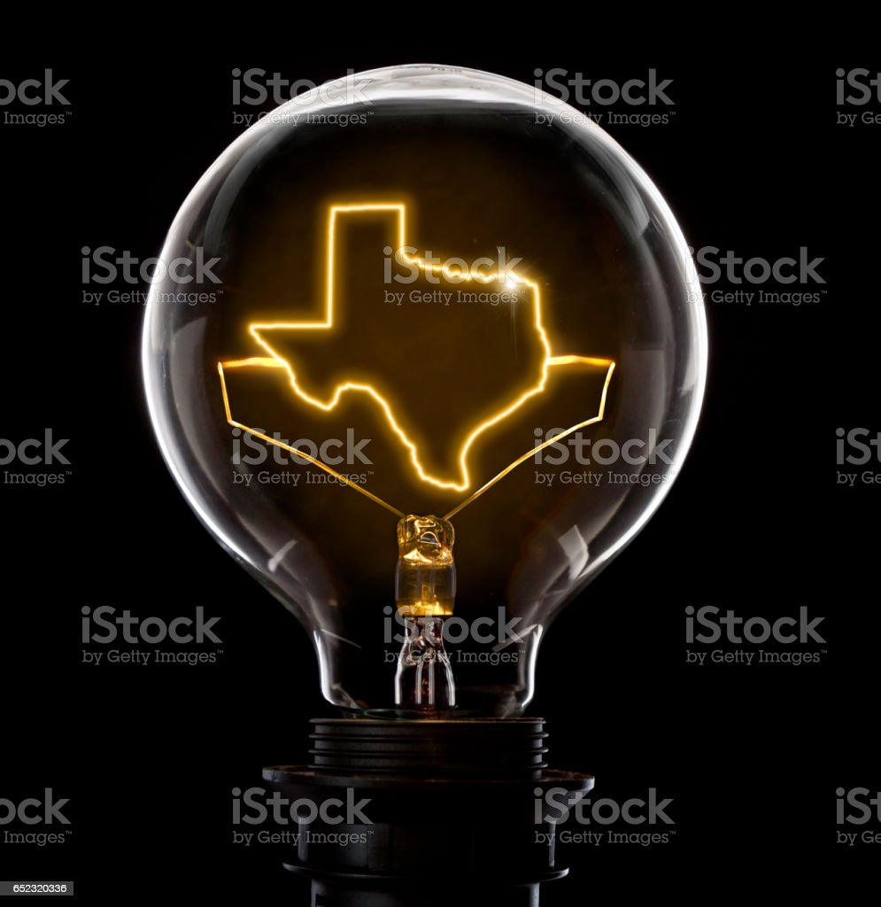 Lightbulb with a glowing wire in the shape of Texas (series) stock photo