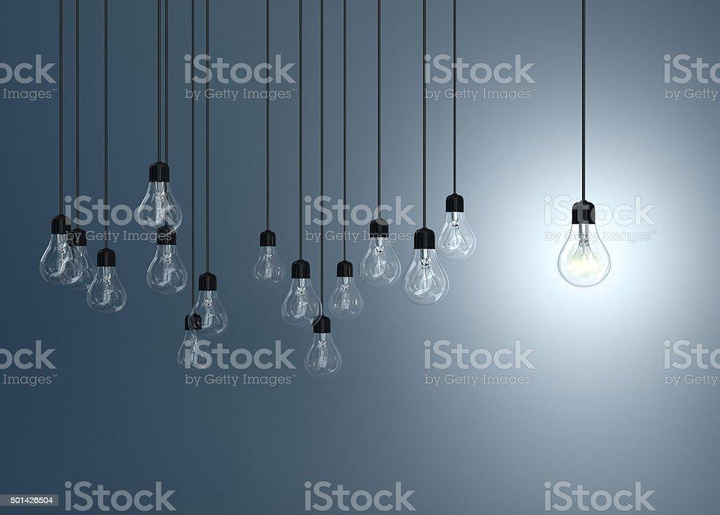 lightbulbs on blue background, stock photo