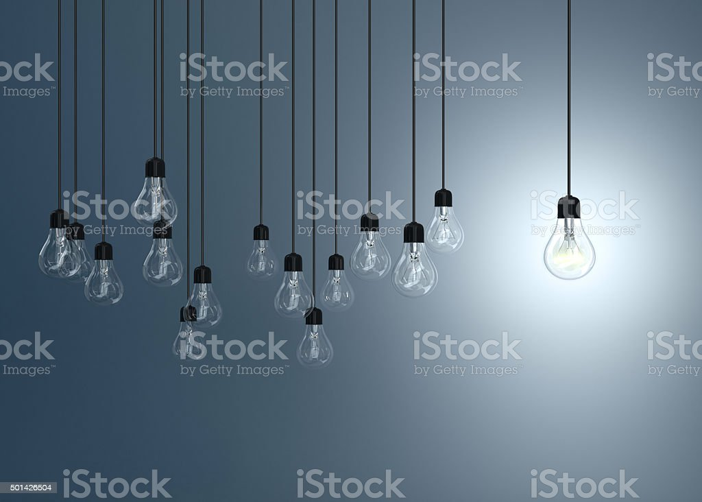 lightbulbs on blue background, stock photo