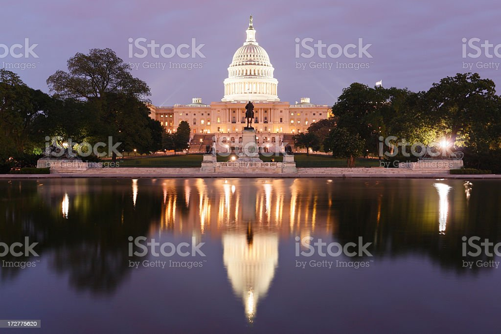 Lighted Capitol Building with reflection royalty-free stock photo