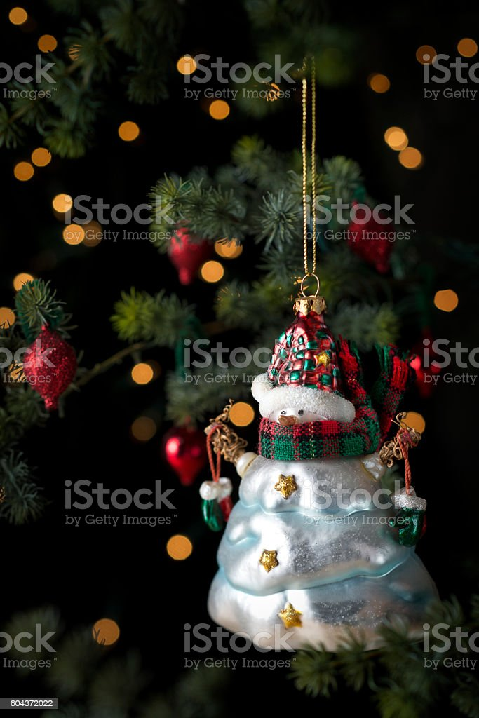 Lighted Christmas Tree with Vintage Snowman Ornament stock photo