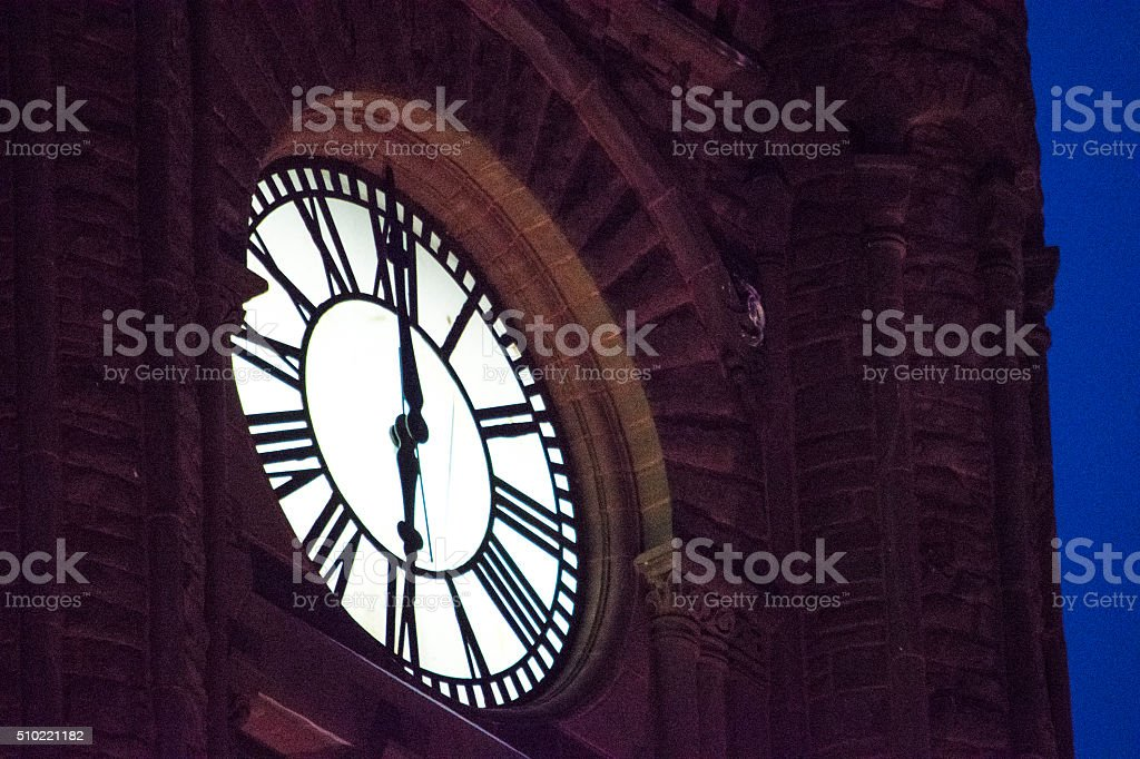 Lighted Clock Tower up close stock photo