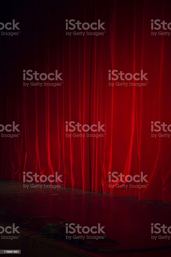 Lighted down red stage curtain royalty-free stock photo