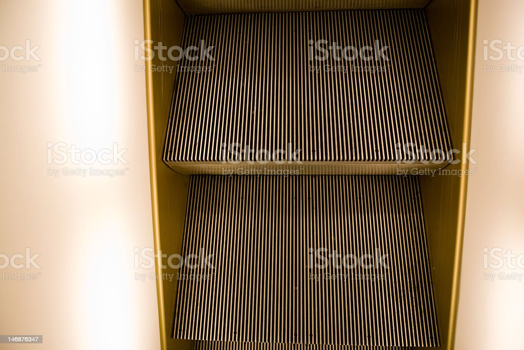 lighted escalator steps stock photo