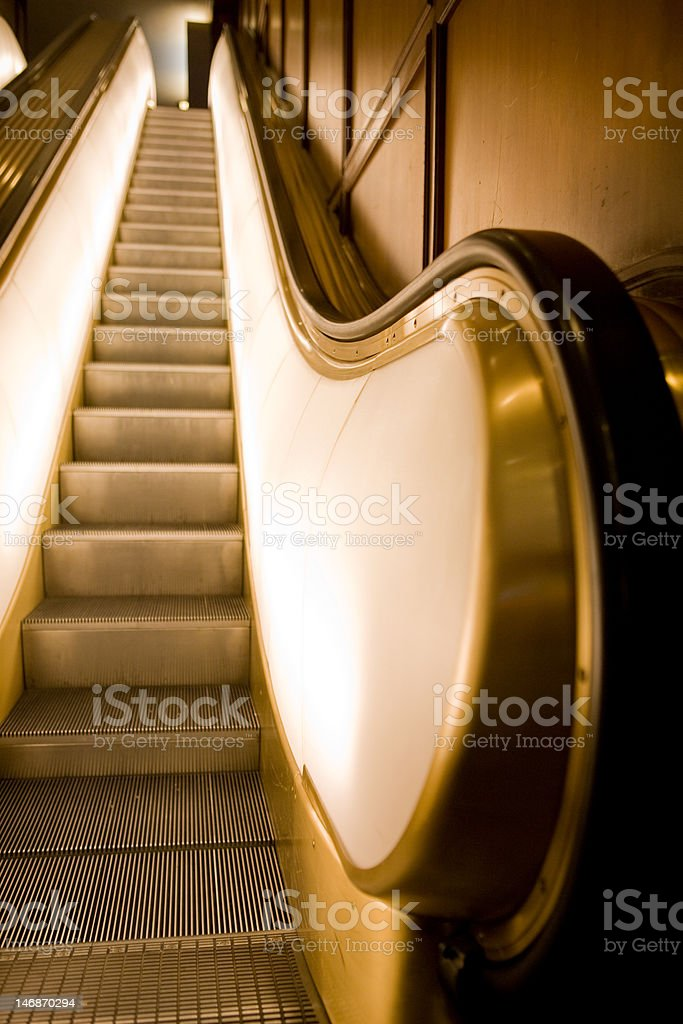 Lighted, Gold Escalator stock photo