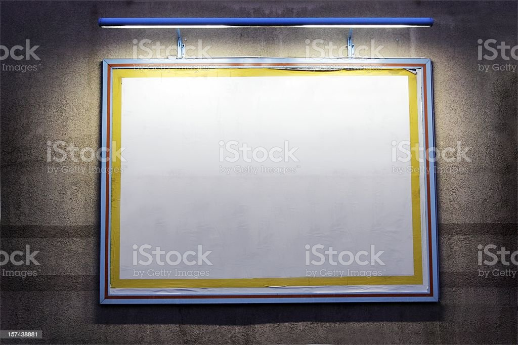 lighted outdoor billboard on a wall at night royalty-free stock photo