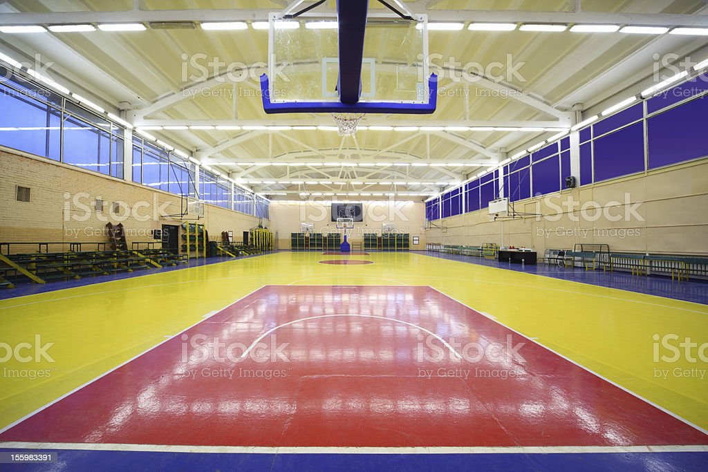 lighted school gym hall with basket royalty-free stock photo