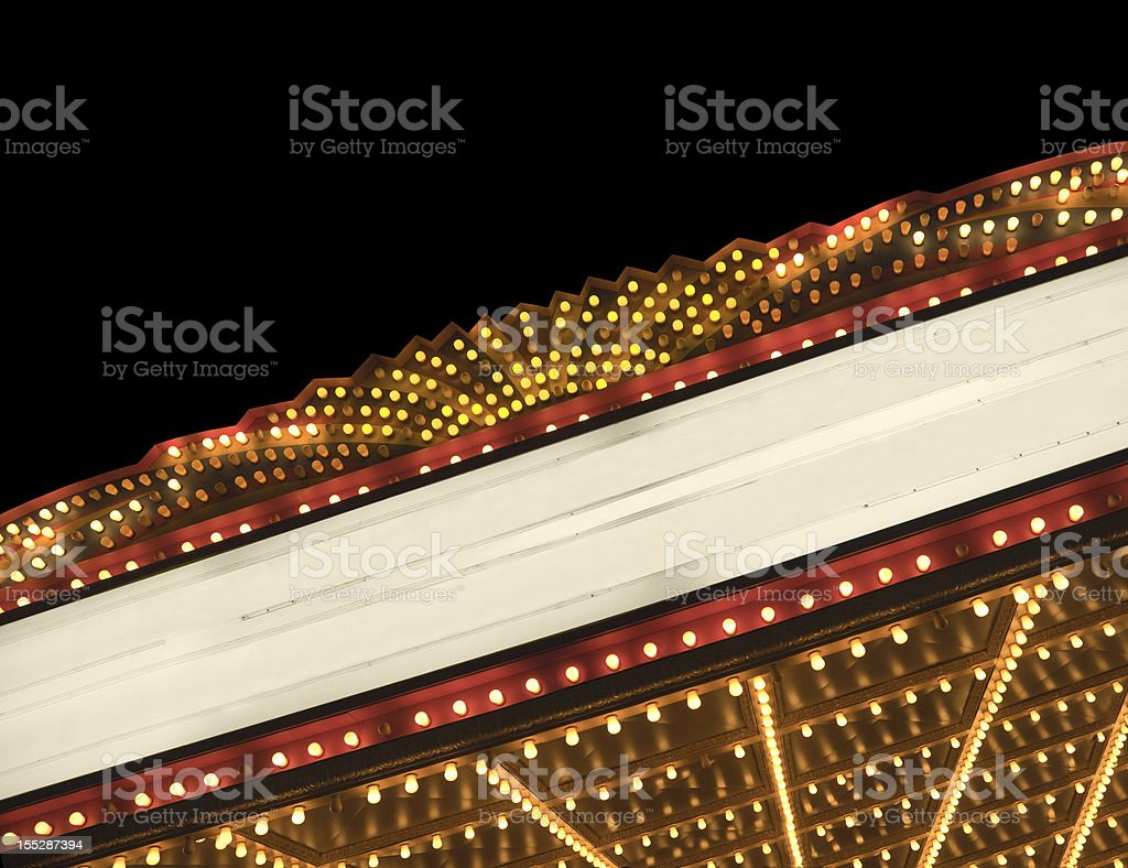 Lighted theater marquee at night with copy space stock photo