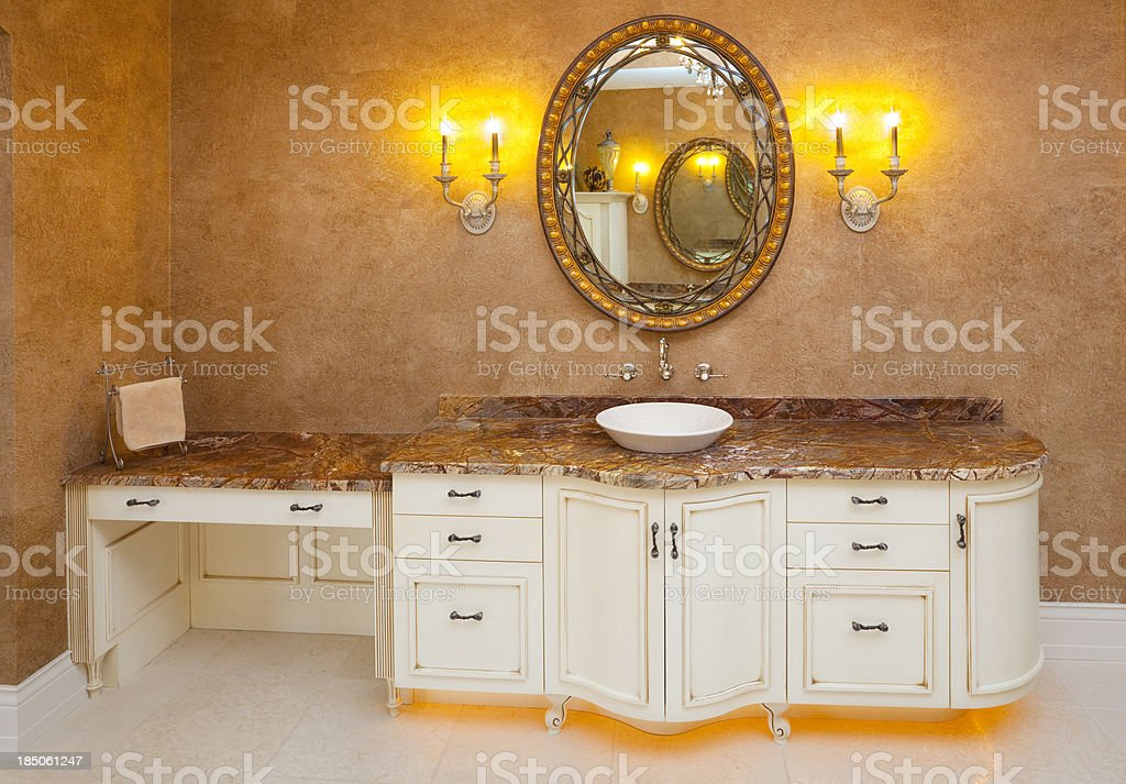 Lighted Vanity Cabinet in Luxurious Master Bathroom royalty free stock photo. Lighted Vanity Cabinet In Luxurious Master Bathroom stock photo