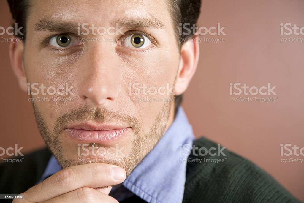 Lighted View of Handsome Man With Hand on His Chin royalty-free stock photo
