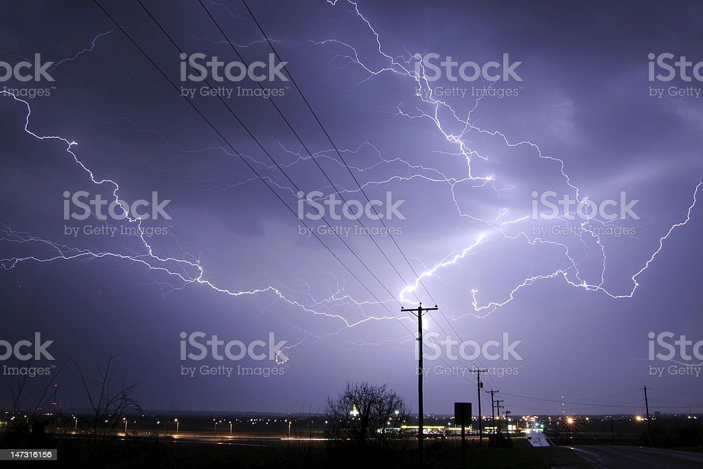 A lightening bolt hits a telegraph pole on a highway royalty-free stock photo