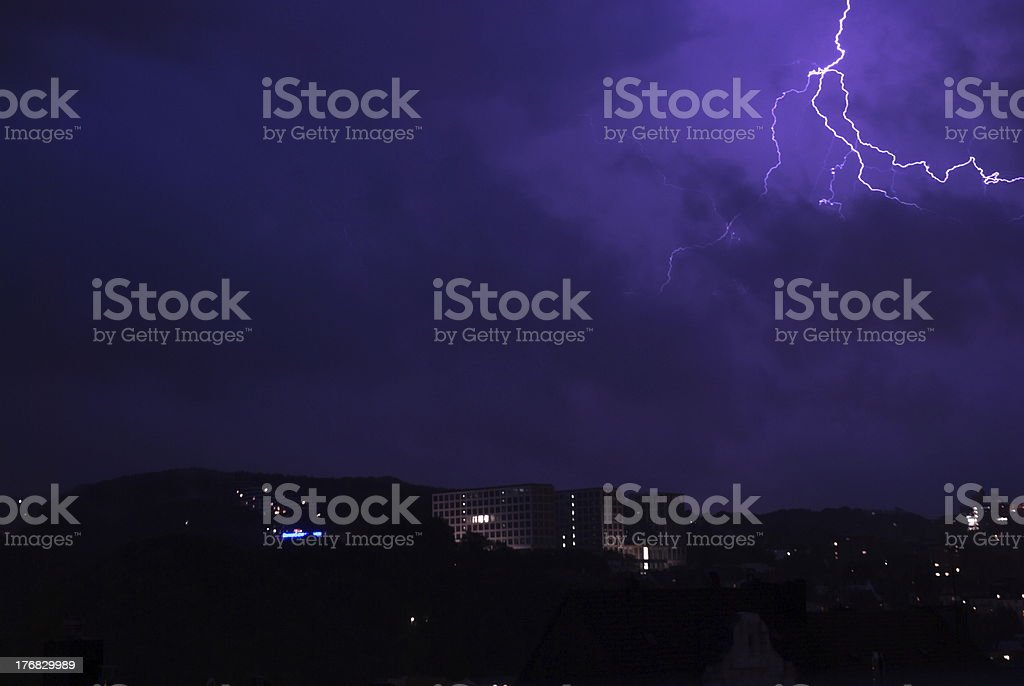 Lightening During Night With Visible Sillhuettes Of Buildings royalty-free stock photo